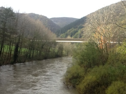 Swollen river, steep sided valley